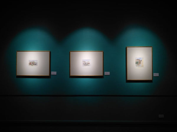three well-lit frames on the wall