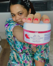 Load image into Gallery viewer, Woman holding Passion Body Wellness scrub by Positive Intent