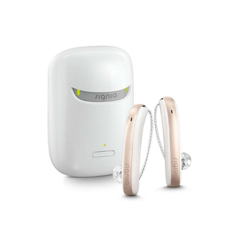 A pair of aesthetic white and rose Signia Styletto 3X/7X hearing aids with white portable charging case