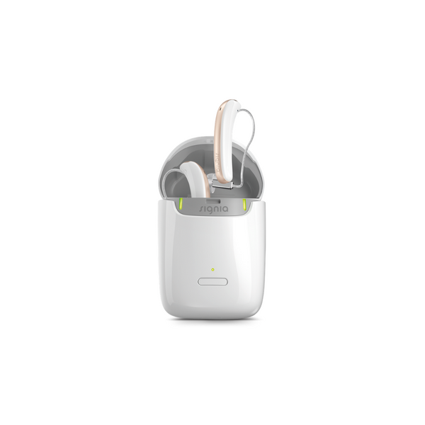 White pockets-sized portable nomad charger with white and rose Signia Styletto 3X/7X hearings aids plugged in