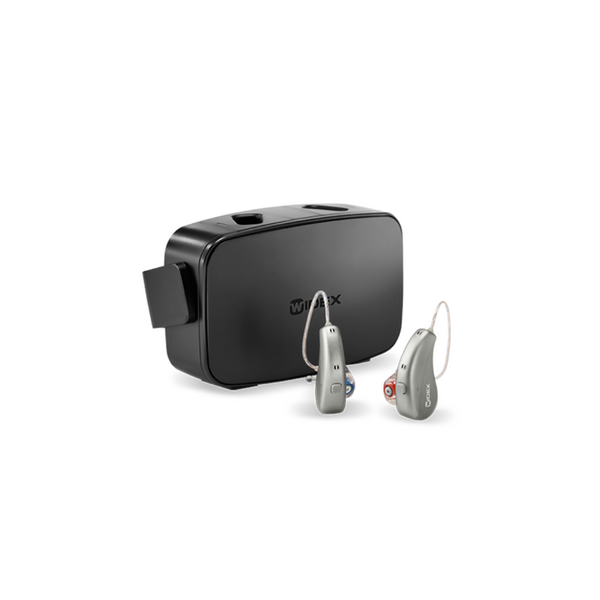 A pair of grey Widex Moment rechargeable hearing aids and a charger in black by Auzen