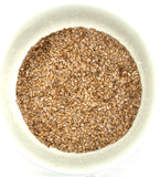 white bowl of flax seed
