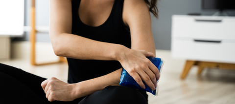 woman icing elbow