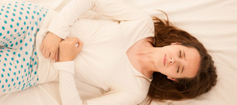 Woman suffering from cramps