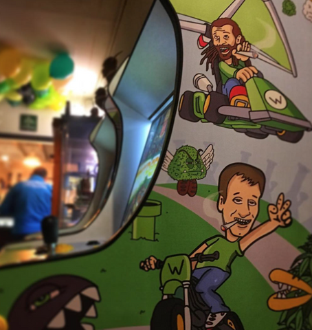 video arcade machine with colourful illustrations by As Rude As Possible (ARAP), stickerbomb