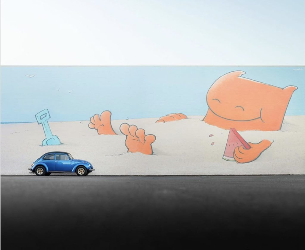 One of Ian Mutch illustration characters lying in the sand eating a piece of watermelon whilst a Volkswagen Beetle sits parked nearby.