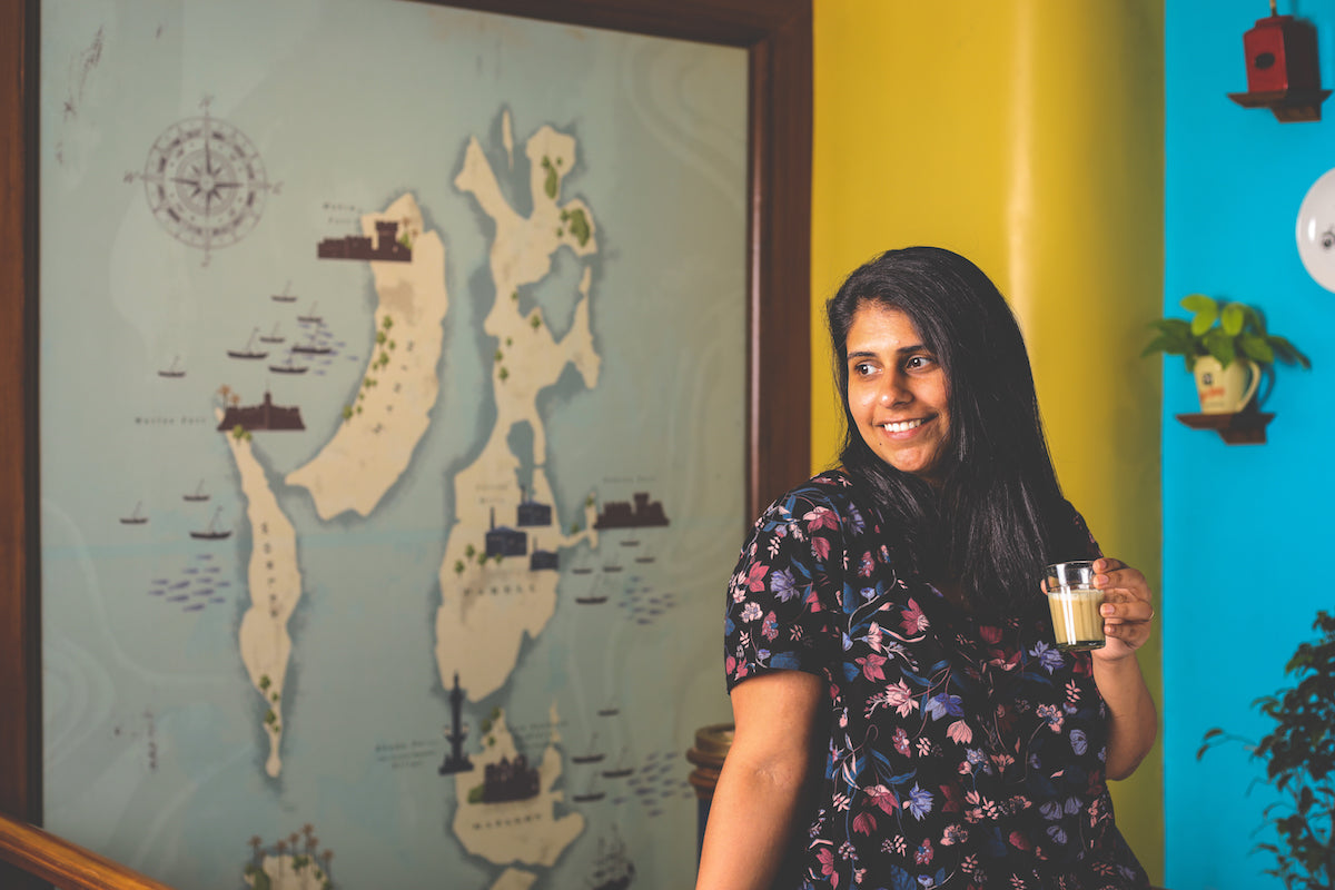 Chef Perzen Patel photographed with a map of Mumbai in the background.