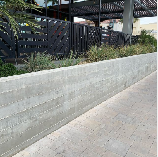 Real concrete board formed half-wall