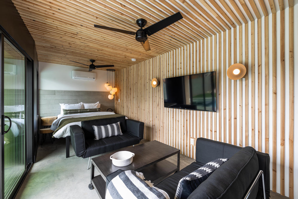 James Judge Bedroom transformation featuring wood slatted walls and ceiling and a concrete headboard using Wall Theory realcast board-form concrete panels