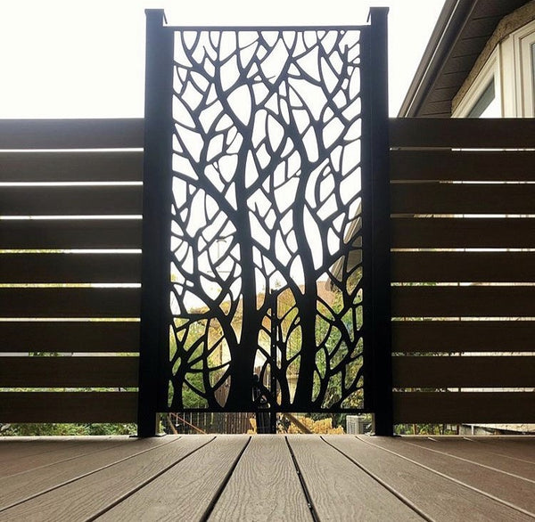 Woodland aluminum privacy screen between wood slat privacy screens on a deck