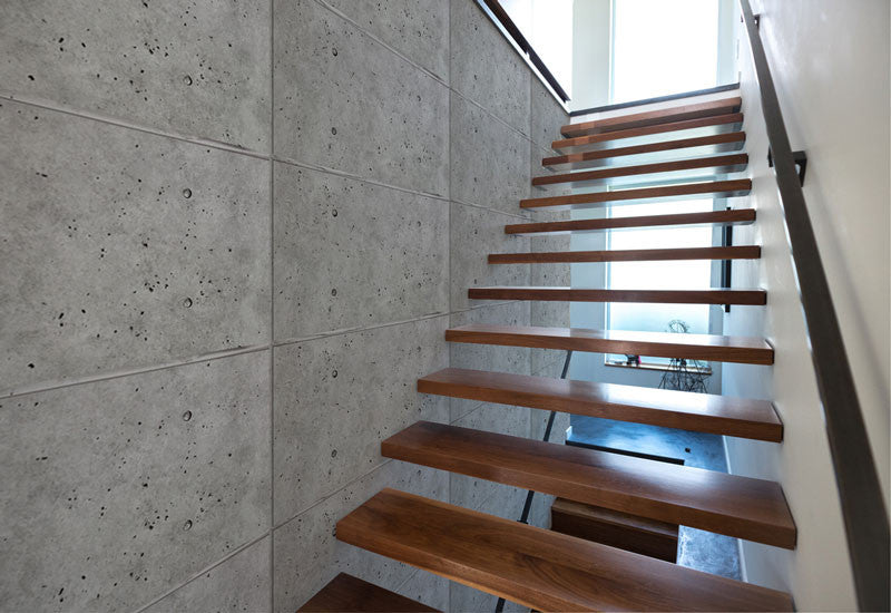 faux concrete panels in the hallway
