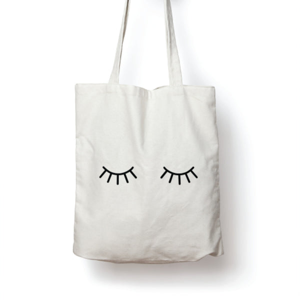 White illustrated winking eyes tote bag online - Sugar and Vice
