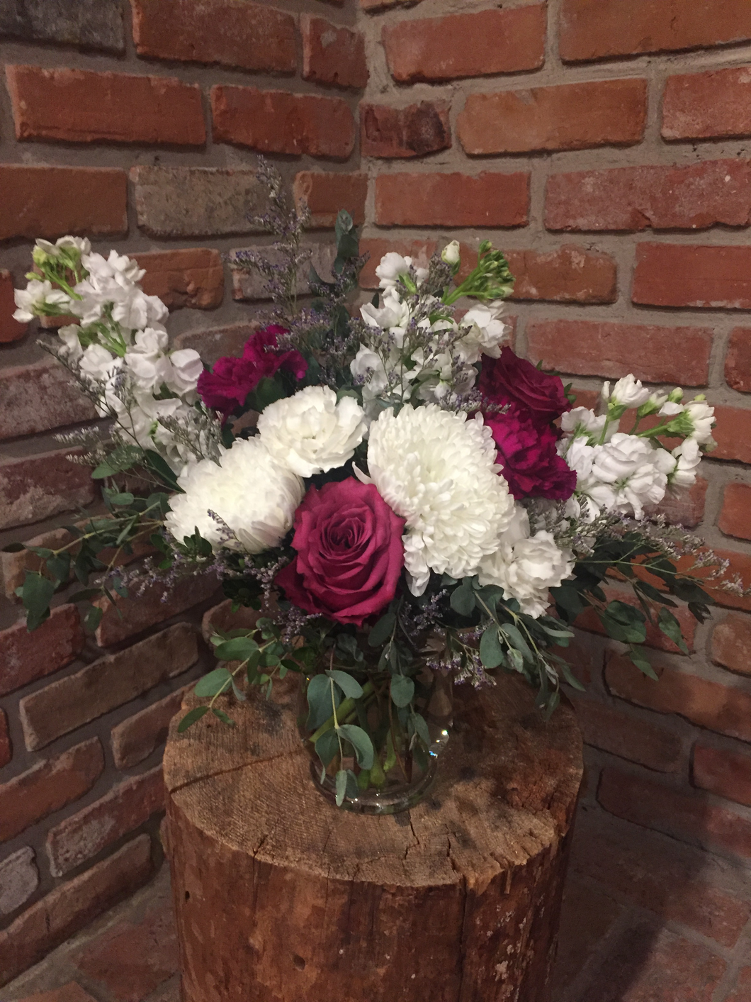 A beautiful garden style vase arrangement including a jumbo white hydrangea, fragrant white stocks, blueberry roses and plum and white carnations. A touch of whispy lavender limonium and an assortment of foliages add loads of texture!
