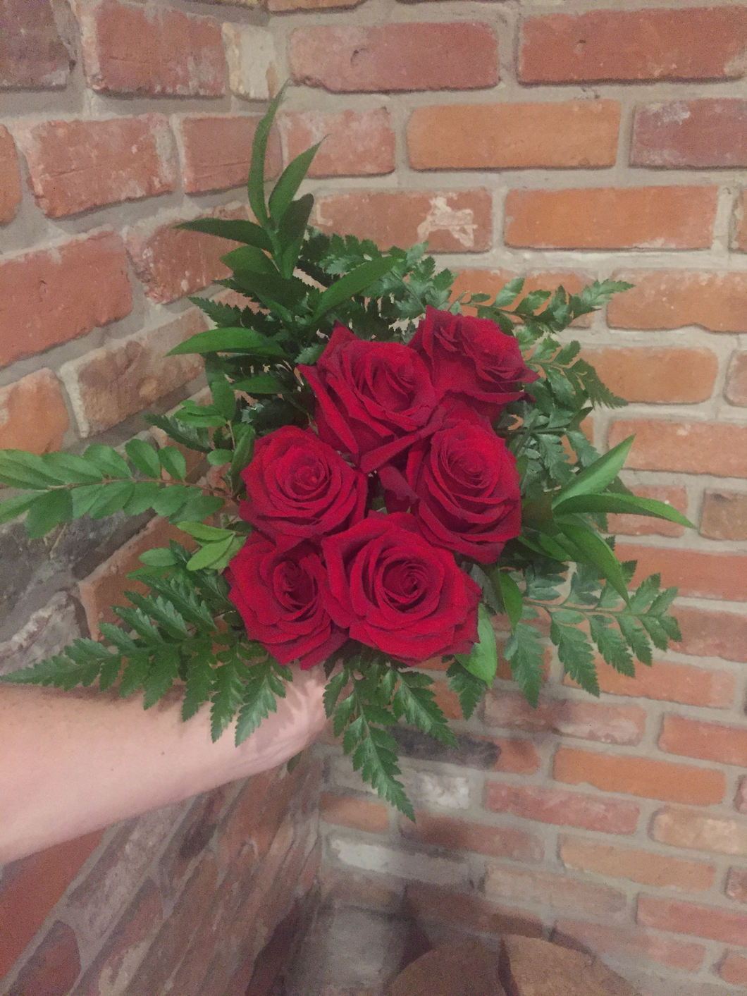 Half dozen of our premium Explorer Red Roses hand tied with an assortment of foliages ready for your recipient to drop in their vase!