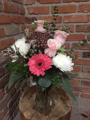 A popular choice full of texture! Shades of pink in roses and Gerber daisy with white Cremons and a variety of fillers and premium foliages