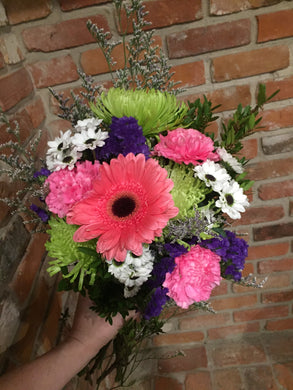A cheerful mix of long lasting blooms!  All orders are subject to substitutions as needed. Our designers will take care to preserve the aesthetic and value of your original choice.   Available for delivery in Kenora.