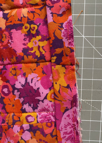 Binding fully sewn down on wrong size of quilt