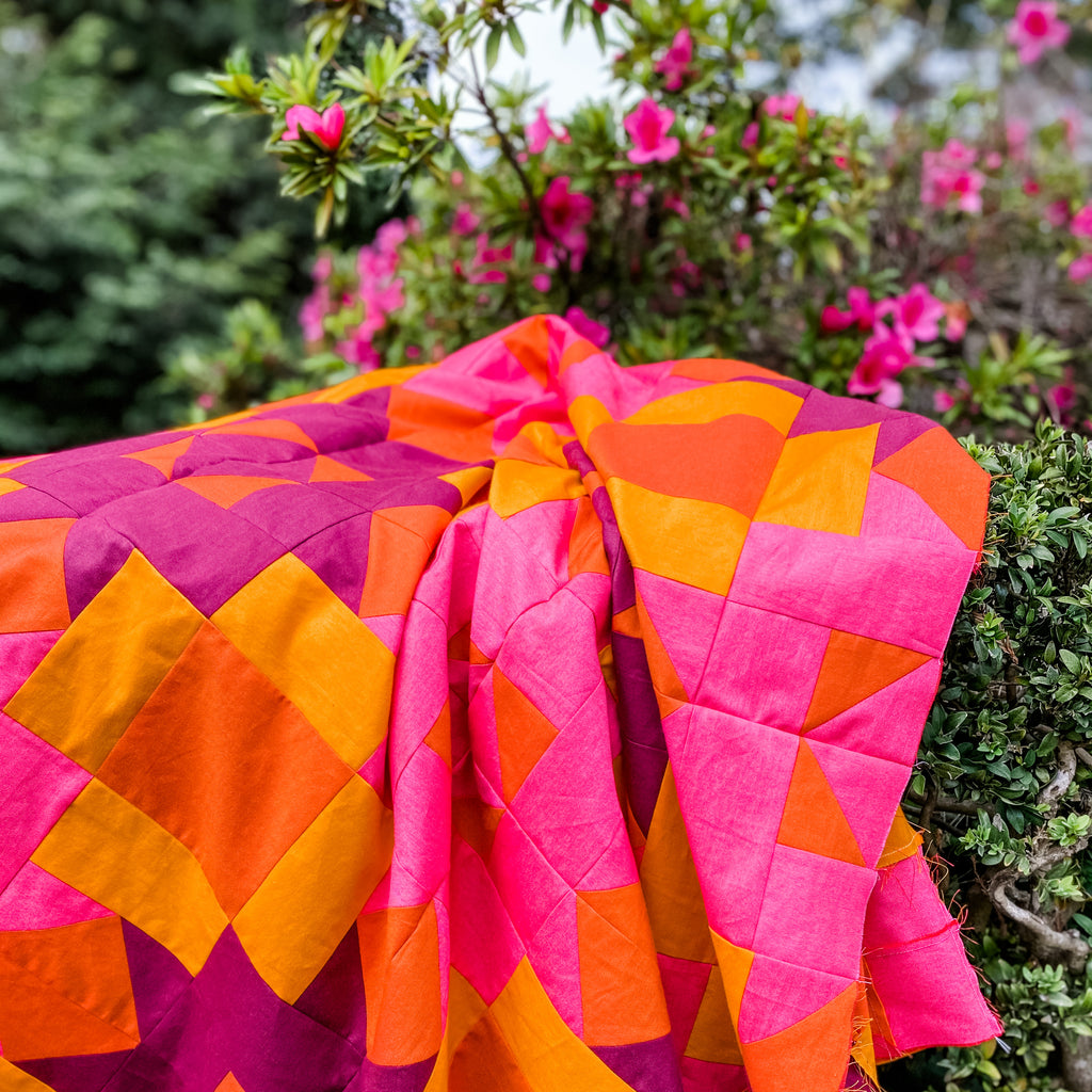Bright pink and orange quilt with azaleas