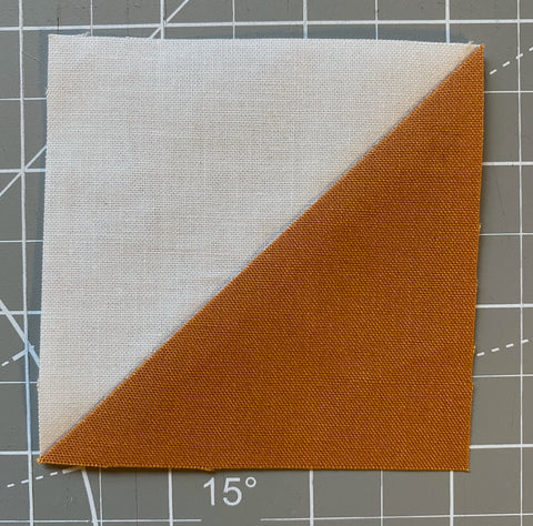 Finished and trimmed half-square triangle.