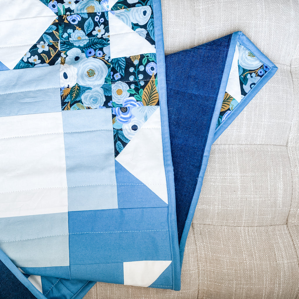 petal points baby quilt in kona cotton blue and rifle paper co garden party fabric