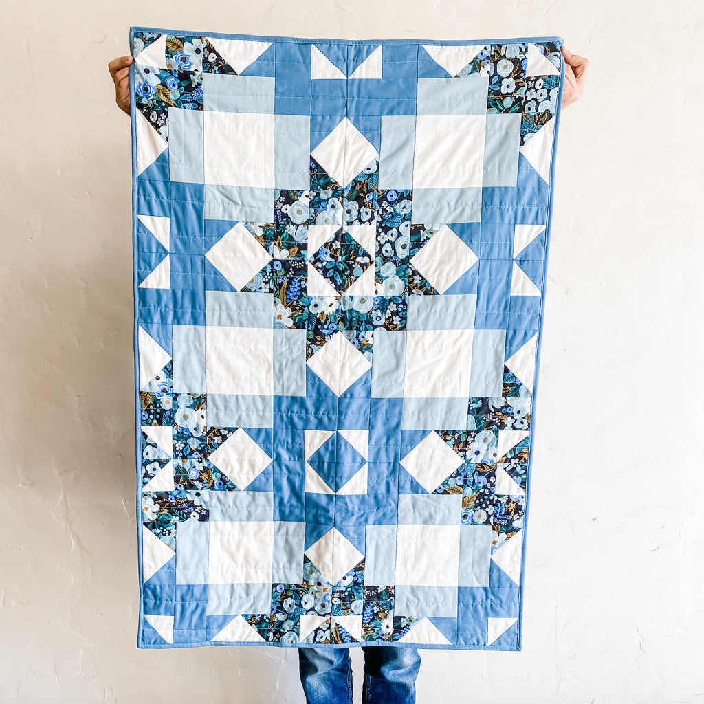 petal points baby quilt in blue kona cotton and rifle paper co fabric