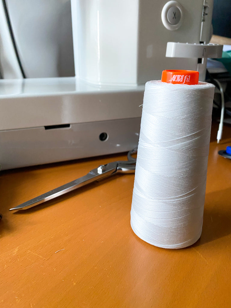 aurifil 50 wt cone in white - my go-to thread for everything