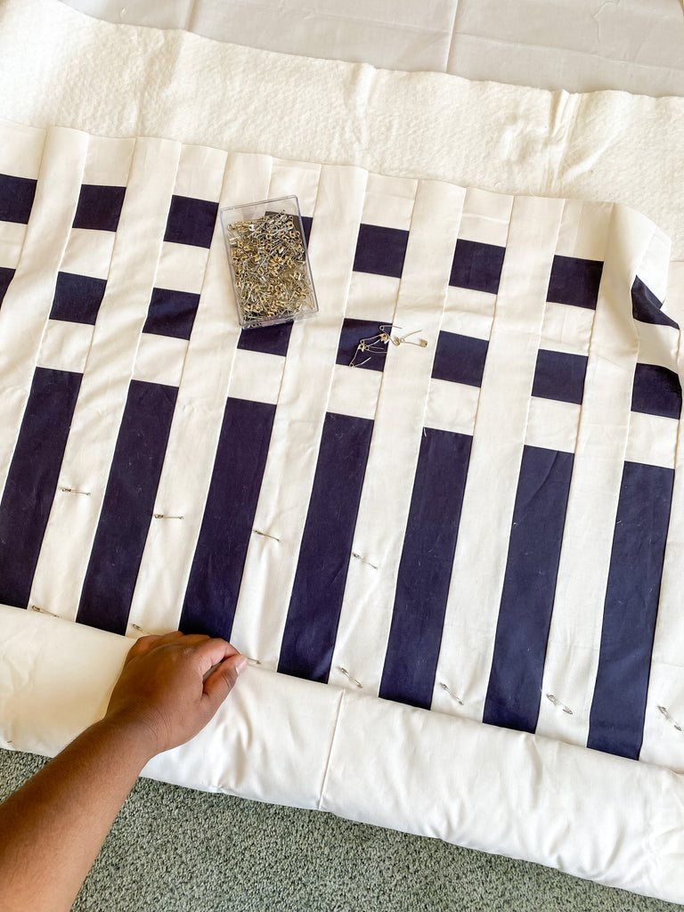 pin basting a quilt - simple stripes quilt by strawberry creek quilts