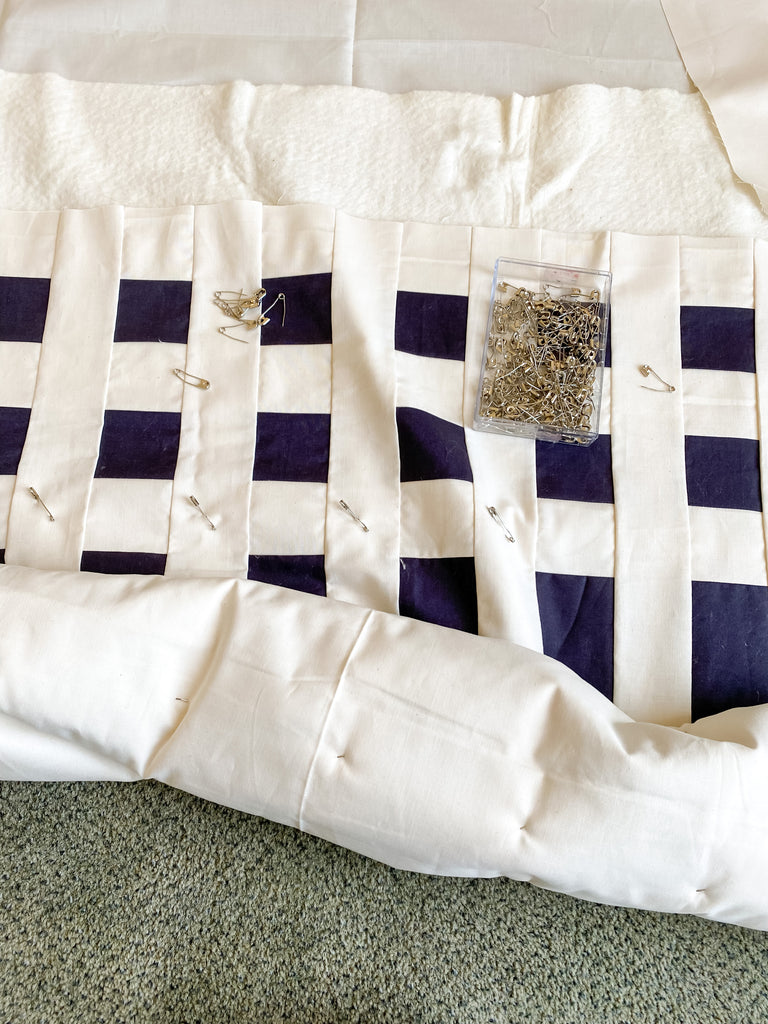 how to baste a quilt - simple stripes quilt - rolling a quilt during pin basting
