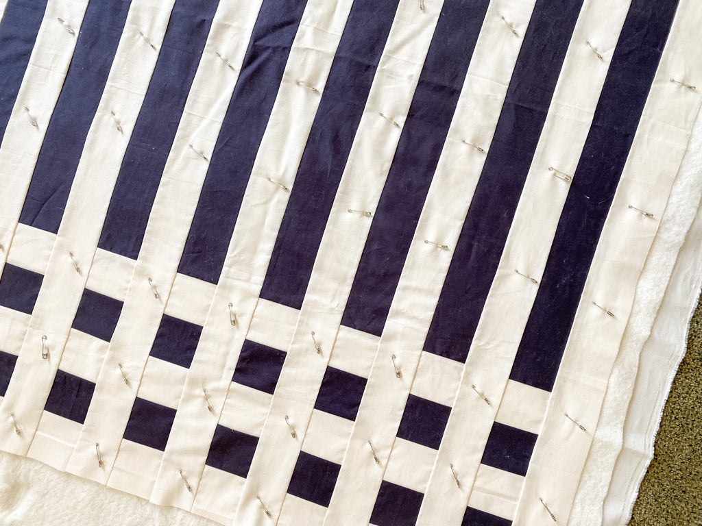 how to baste a quilt - simple stripes quilt - basted quilt with bent safety pins
