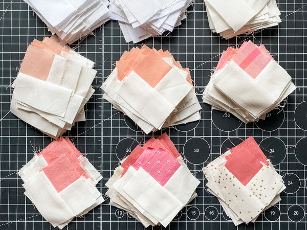the makings of joy - scrap mountain quilt - in progress - log cabin blocks pink and white