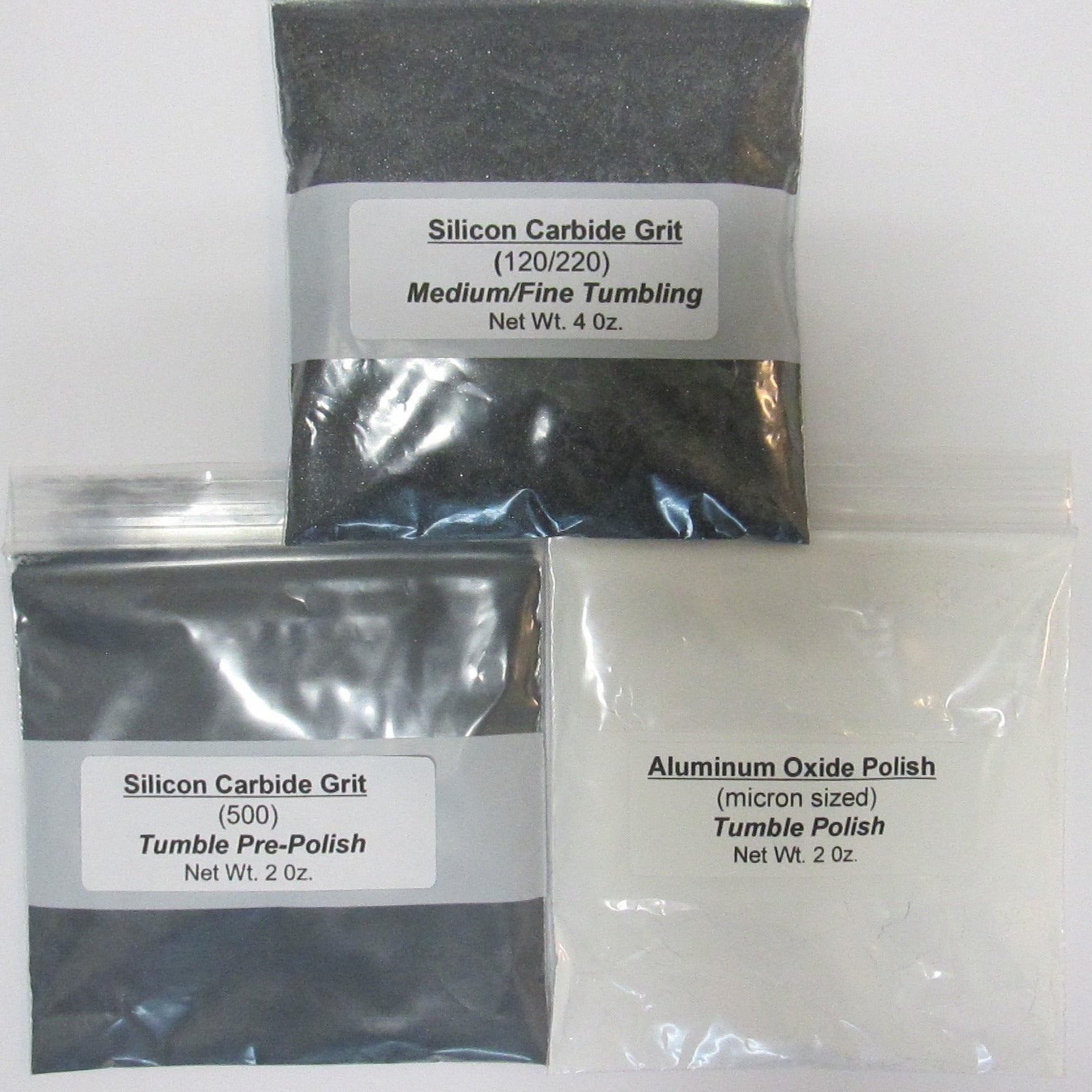 Vibratory tumbler grit kit with silicon carbide, aluminum oxide