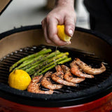 Kamado Joe Jr. portable griller with shrimp and asparagus