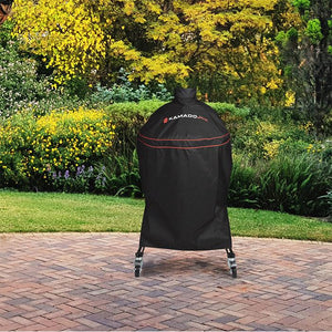 A Heavy Duty Grill Cover being used on a Classic Joe in a backyard
