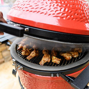 Chicken wings being cooked on the Kamado Joe Classic II.