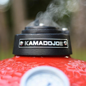 Kamado Joe Jr. portable griller upclose of top vent smoking