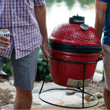 Kamado Joe Jr. portable griller being carried to new location