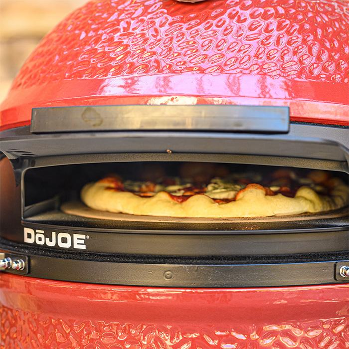 A pizza cooking in the DõJoe