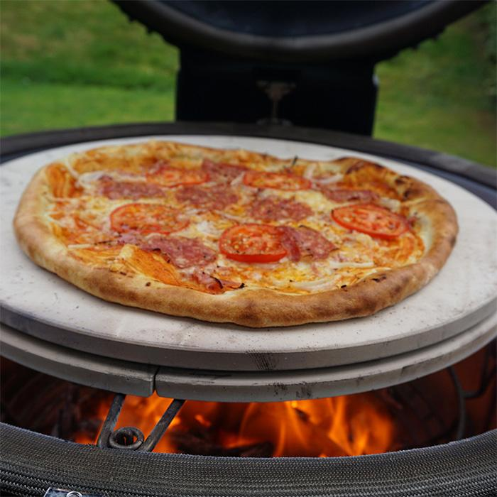 A pizza being cooked on the Big Joe® Ceramic Pizza Stone