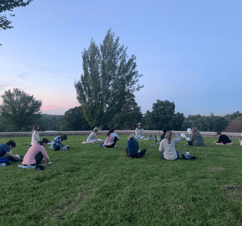 People doing yoga and pottery at Larz Anderson Park