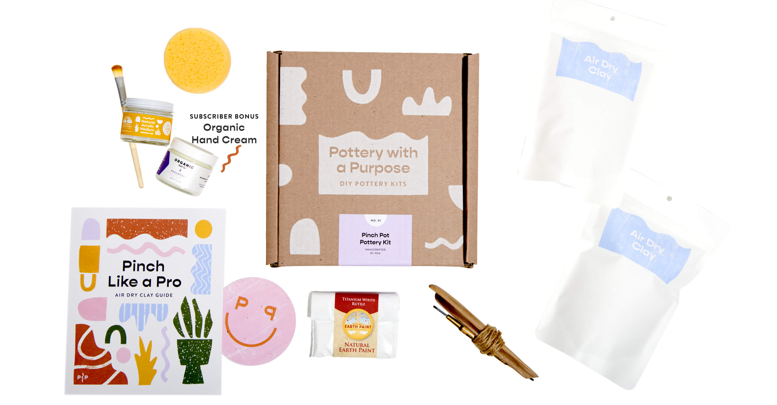 Included with your make at home air dry clay kit is sculting tools, a sponge, a koster, your ping guide, acrylic paint, a vegan paintbrush, powder paint and subscription members also get a bonus hand cream.