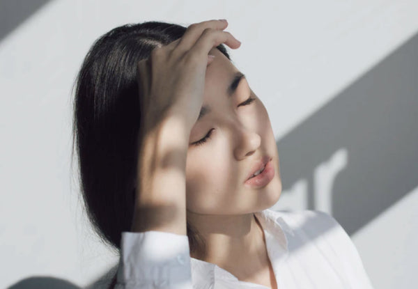 Woman with eyes closed, blinking