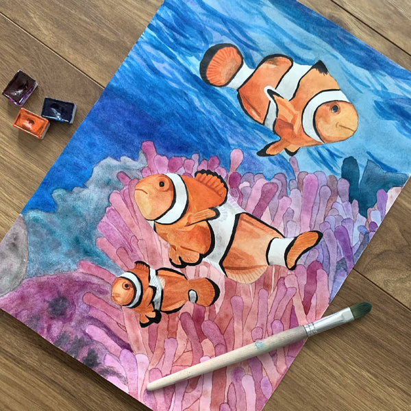 Bright Blue Ocean Orange Clownfish Watercolour Painting Wall Décor in a White Wooden Frame