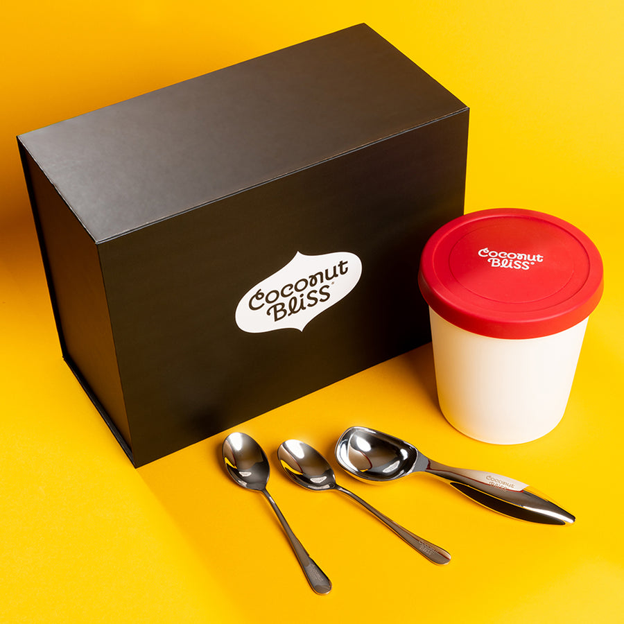 Bundle box with plastic ice cream pint, ice cream scoop and spoons.