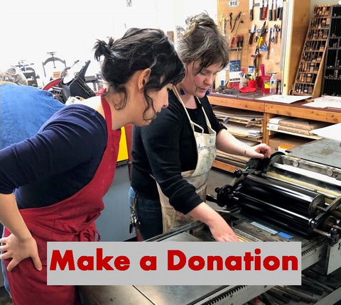 Make a Donation - two women working on the letterpress