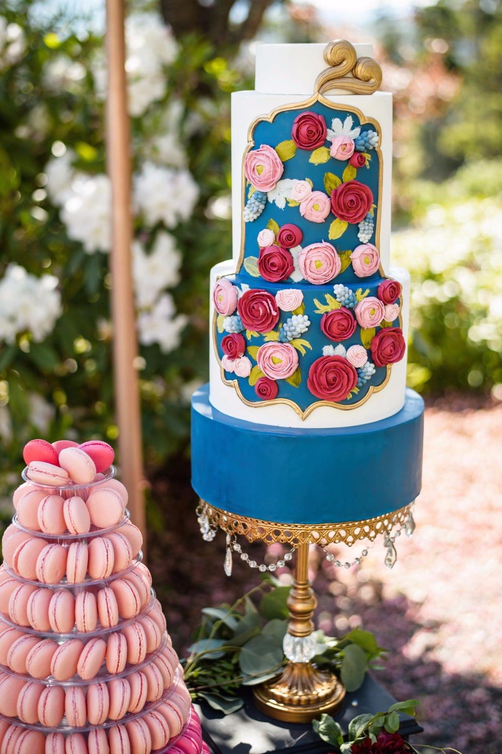 colorful tiered wedding cake on chandelier ball base cake stand