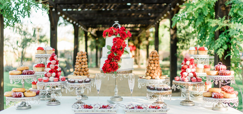 wedding dessert table with wedding cake donuts cupcakes on silver cake stands