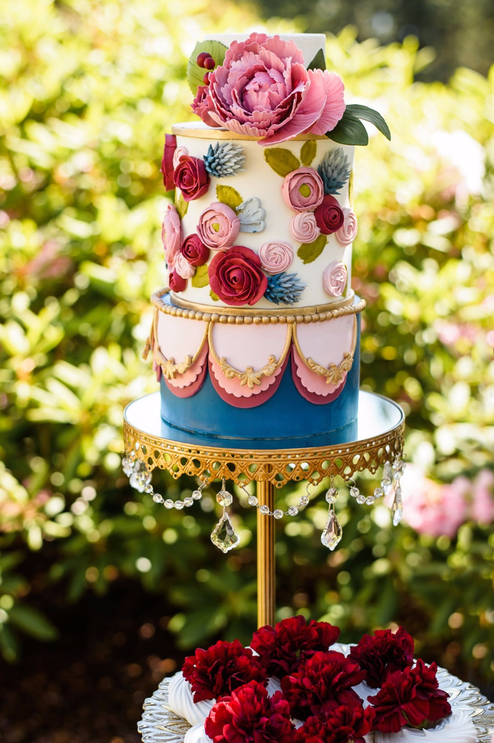 marie antoinette inspired colorful wedding cake on gold cake stand