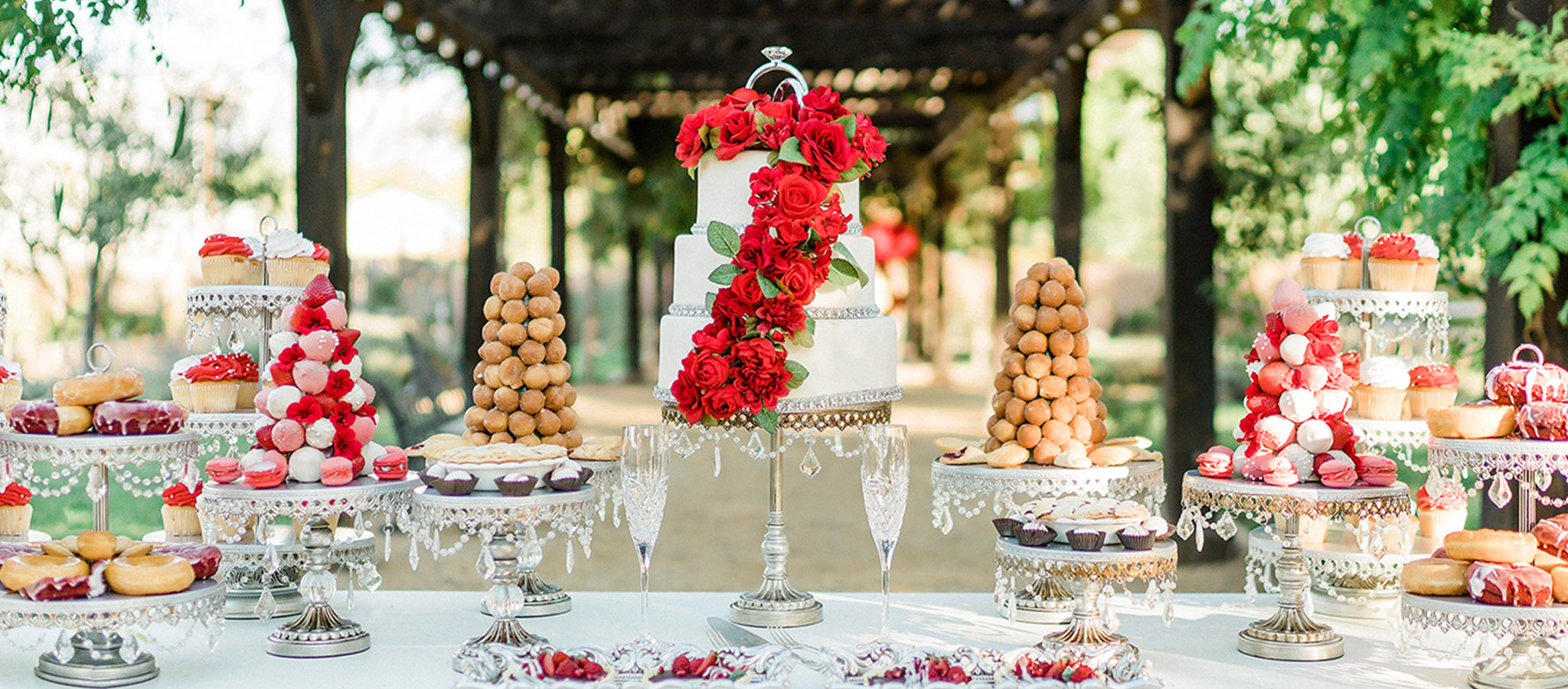chandelier cake stands and dessert stands on wedding cake table