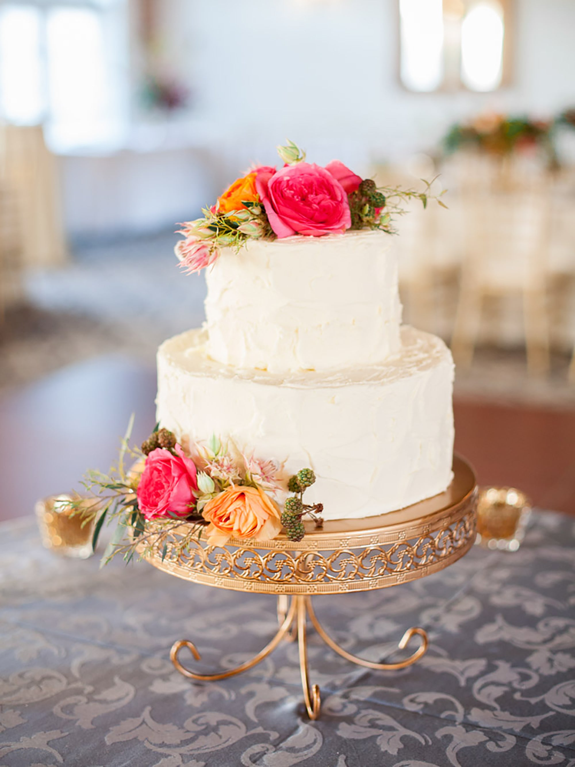 gold wedding cake stand with 2 tier ivory wedding cake