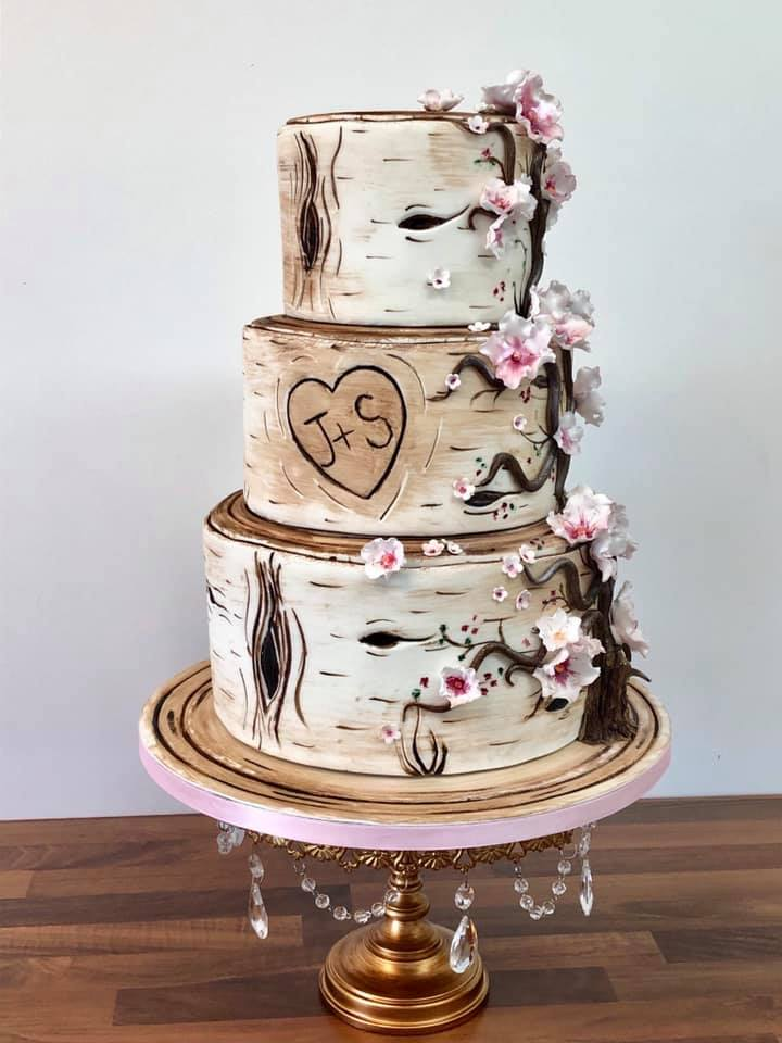 rustic wood carved wedding cake on gold chandelier cake stand